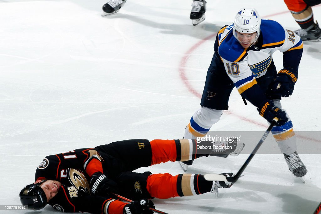 Ryan Getzlaf of the Anaheim Ducks falls to the ice after a