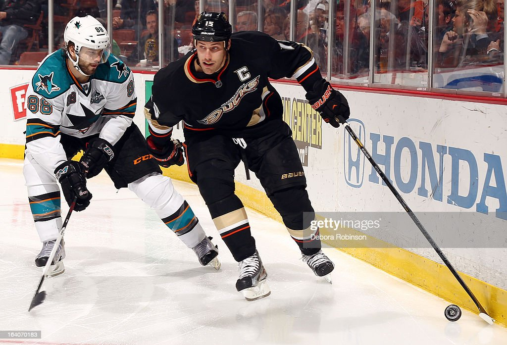 Ryan Getzlaf #15 of the Anaheim Ducks handles the puck against Brent Burns #88 of the San Jose Sharks on March 18, 2013 at Honda Center in Anaheim, California.