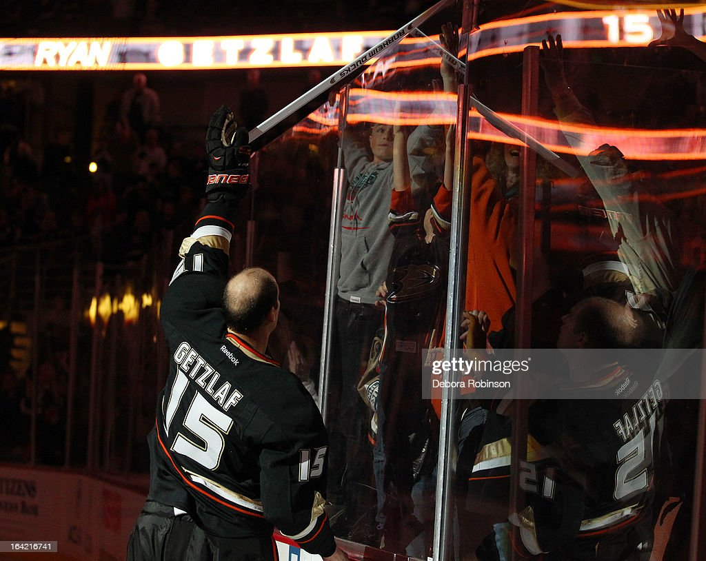 Ryan Getzlaf #15 of the Anaheim Ducks hands a game used stick to a fan after the Ducks' 4-2 win over the Chicago Blackhawks on March 20, 2013 at Honda Center in Anaheim, California.