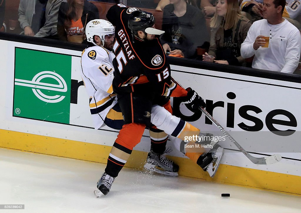 Ryan Getzlaf of the Anaheim Ducks is hit in the face with a