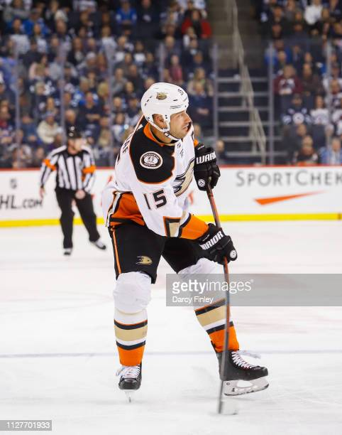 Ryan Getzlaf of the Anaheim Ducks plays the puck down the ice during third period action against the Winnipeg Jets at the Bell MTS Place on February...