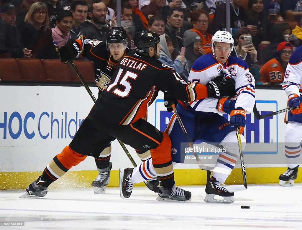 Ryan Getzlaf #15 of the Anaheim Ducks reaches out to slow up Connor McDavid #97 of the Edmonton Oilers during the second period at the Honda Center on January 25, 2017 in Anaheim, California.