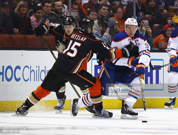 Ryan Getzlaf of the Anaheim Ducks reaches out to slow up Connor McDavid of the Edmonton Oilers during the second period at the Honda Center on...
