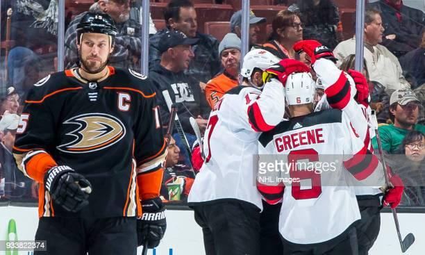 Ryan Getzlaf of the Anaheim Ducks reacts as Patrick Maroon and Andy Greene of the New Jersey Devils celebrates Maroon's thirdperiod goal during the...