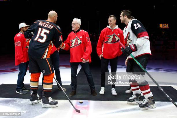 Ryan Getzlaf of the Anaheim Ducks shakes hands with manager of the Anaheim Angels, Joe Maddon after a ceremonial puck drop with Angels players David...