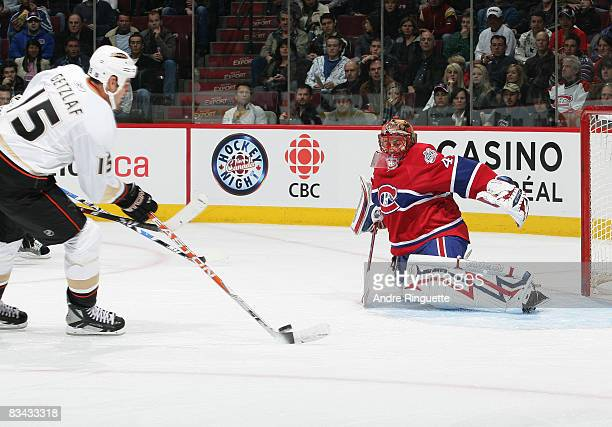 Ryan Getzlaf of the Anaheim Ducks shoots the puck against Jaroslav Halak of the Montreal Canadiens for a first period goal at the Bell Centre on...