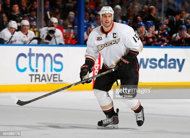 Ryan Getzlaf of the Anaheim Ducks skates against the New York Islanders at Nassau Veterans Memorial Coliseum on December 21, 2013 in Uniondale, New...