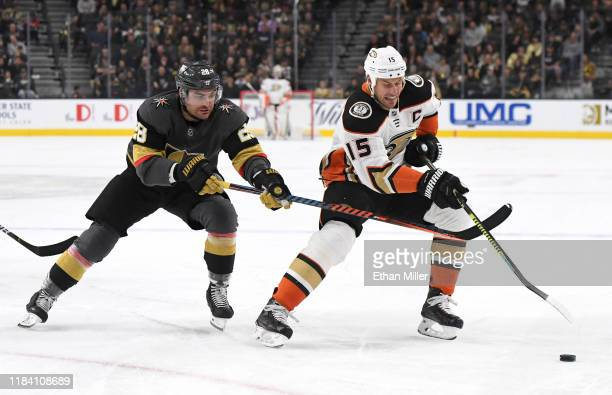Ryan Getzlaf of the Anaheim Ducks skates with the puck against William Carrier of the Vegas Golden Knights in the first period of their game at...