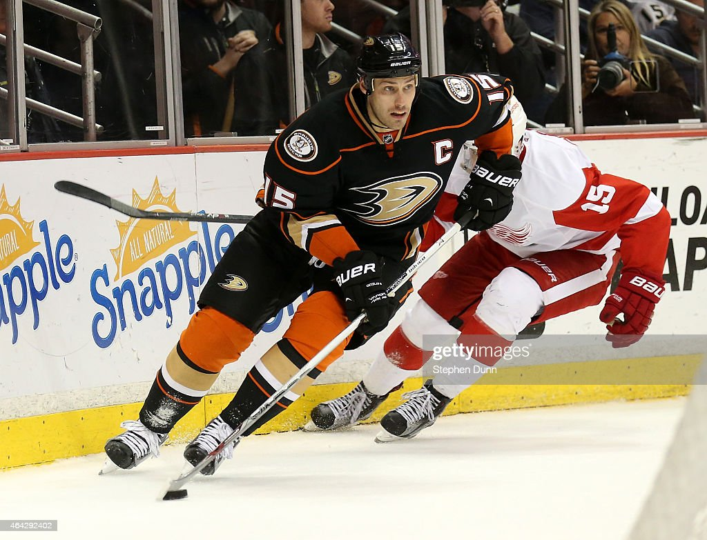 Ryan Getzlaf #15 of the Anaheim Ducks skates with the puck ahead of Riley Sheahan #15 of the Detroit Red Wings at Honda Center on February 23, 2015 in Anaheim, California. The Ducks won 4-3 in a shootout.