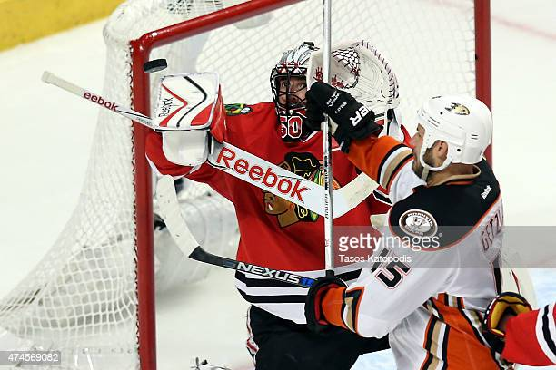 Ryan Getzlaf of the Anaheim Ducks tries to deflect the puck against Corey Crawford of the Chicago Blackhawks in the first overtime period of Game...