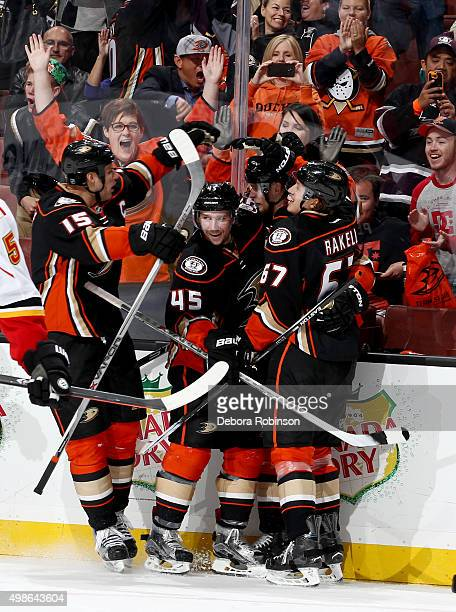 Ryan Getzlaf Sami Vatanen Corey Perry and Rickard Rakell of the Anaheim Ducks celebrate a third period goal against the Calgary Flames on November 24...