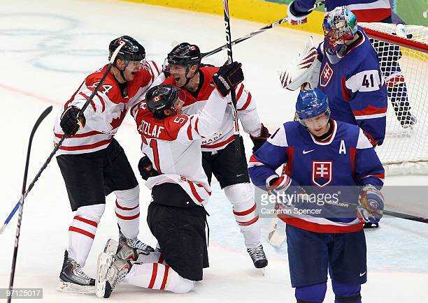 Ryan Getzlaf#51 of Canada celebrates with his team mates after he scored past Goalkeeper Jaroslav Halak of Slovakia during the ice hockey men's...