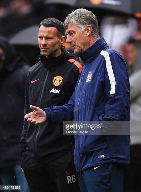 Ryan Gigg assistant manager of Manchester United and coassistant Manager of Manchester City Brian Kidd in discussion prior to the Barclays Premier...