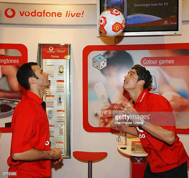 Ryan Giggs and Cristiano Ronaldo of Manchester United juggle with a ball as Manchester United announced a new sponsorship deal with Vodafone at...