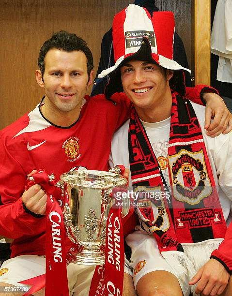 Ryan Giggs and Cristiano Ronaldo of Manchester United pose with the Carling Cup trophy in the dressing room after the Carling Cup Final match between...