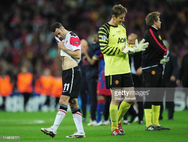 Ryan Giggs and Edwin van der Sar of Manchester United show their dejection after the UEFA Champions League final between FC Barcelona and Manchester...