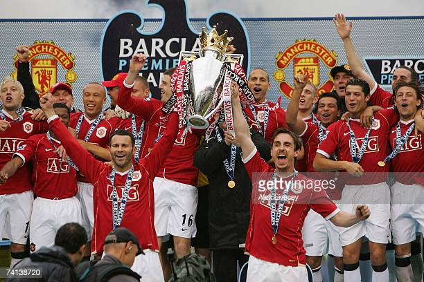 Ryan Giggs and Gary Neville of Manchester United lift the Premiership trophy as their team celebrate winning the Premiership title at the end of the...