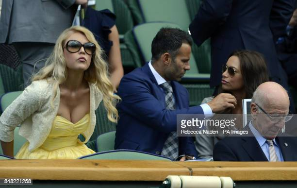 Ryan Giggs and his wife Stacey sit next to Camilla Kerslake in the Royal Box during day six of the 2012 Wimbledon Championships at the All England...