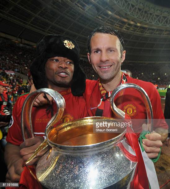 Ryan Giggs and Patrice Evra of Manchester United hold the trophy after the UEFA Champions League Final match between Manchester United and Chelsea at...