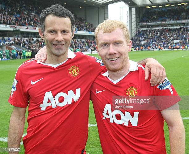 Ryan Giggs and Paul Scholes of Manchester United celebrates winning the Premier League title after the Barclays Premier League match between...