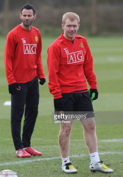 Ryan Giggs and Paul Scholes of Manchester United in action during a First Team Training Session at Carrington Training Ground on March 7 2008 in...