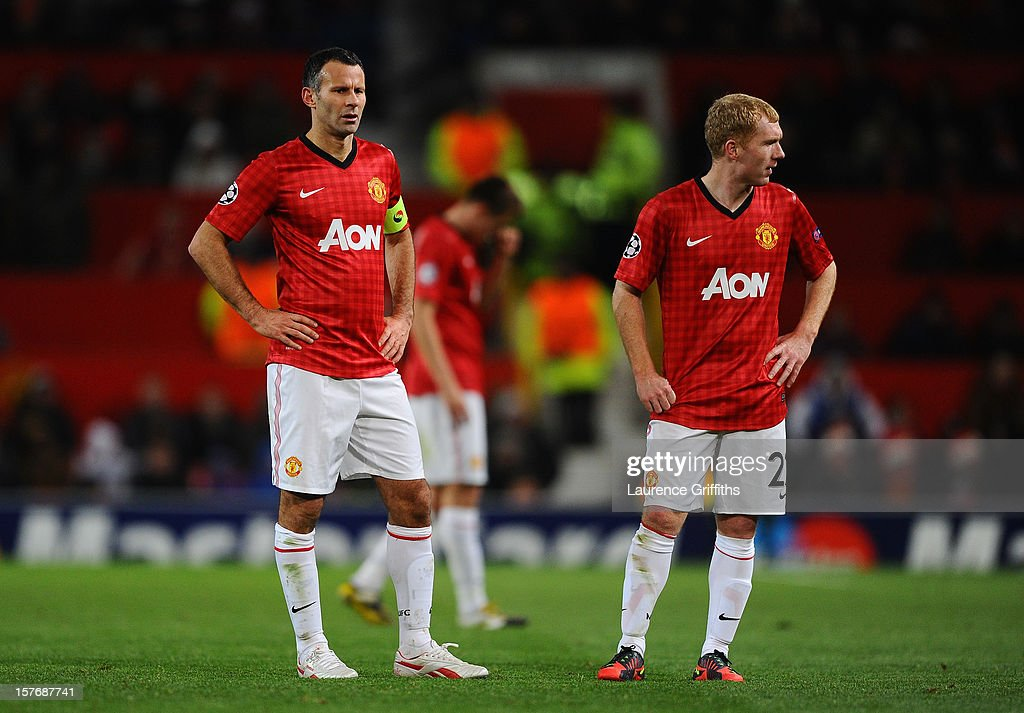 Ryan Giggs and Paul Scholes of Manchester United look on dejectedly during the UEFA Champions League Group H match between Manchester United and CFR 1907 Cluj at Old Trafford on December 5, 2012 in Manchester, England.