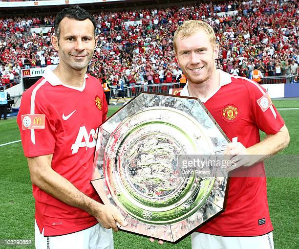 Ryan Giggs and Paul Scholes of Manchester United pose with the Community Shield after the FA Community Shield match between Chelsea and Manchester...