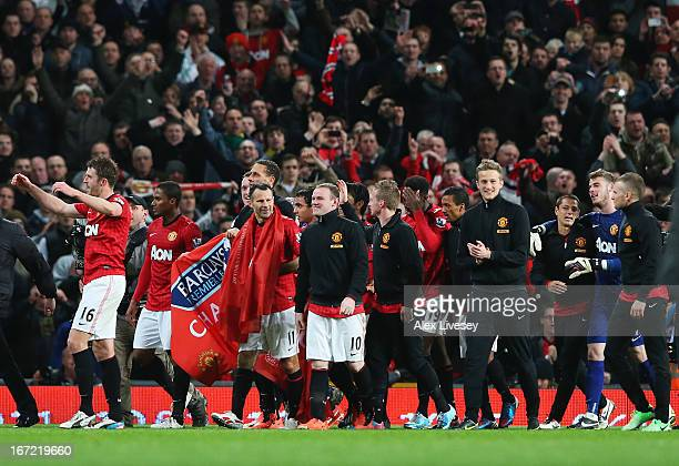 Ryan Giggs and Wayne Rooney of Manchester United celebrate victory and winning the Premier League title with team mates after the Barclays Premier...