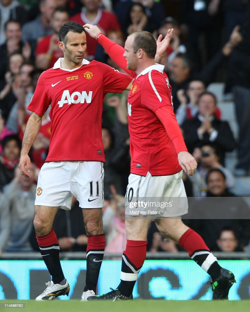 Ryan Giggs (L) and Wayne Rooney of Manchester United in action during Gary Neville's testimonial match between Manchester United and Juventus at Old Trafford on May 24, 2011 in Manchester, England.