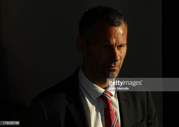 Ryan Giggs arrives for a Manchester United press conference at the Museum of Contemporary Art on July 14 2013 in Sydney Australia