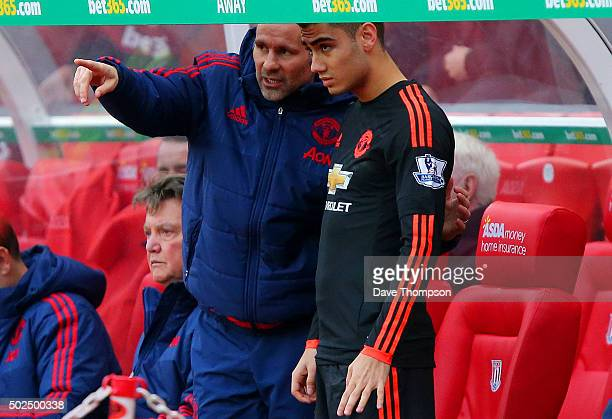 Ryan Giggs assistant manager of Manchester United speaks with Andreas Pereira of Manchester United as he prepares to come on towards the end of the...
