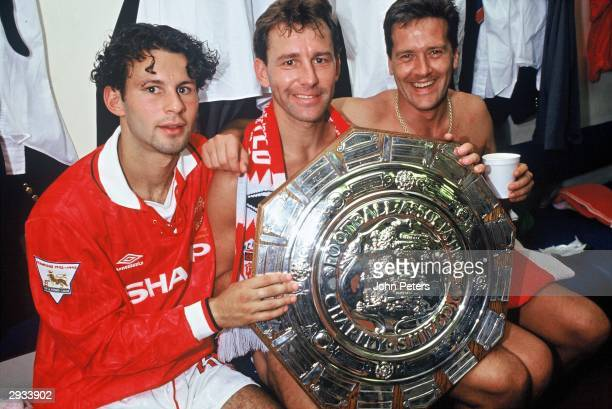Ryan Giggs Bryan Robson and Les Sealey celebrate in the dressing room after the Arsenal v Manchester United Charity Shield match at Wembley Stadium...