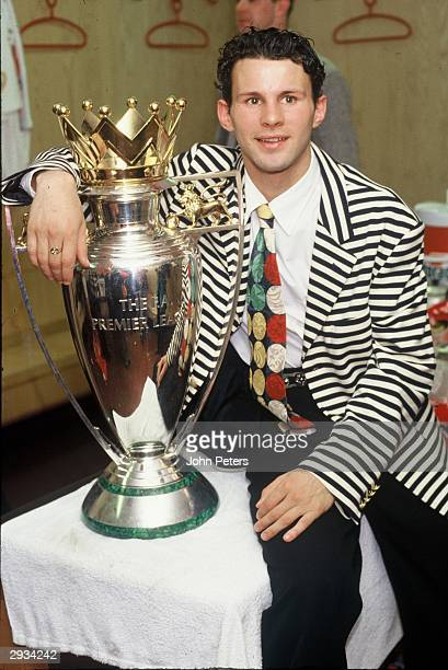 Ryan Giggs celebrates with the Premiership Trophy in the dressing room after the FA Carling Premiership Match between Manchester United v Blackburn...