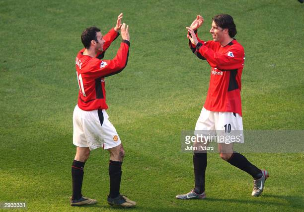 Ryan Giggs congratulates Ruud Van Nistelrooy after his goal during the FA Barclaycard Premiership match between Manchester United v Fulham at Old...