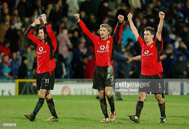 Ryan Giggs David Beckham and Gary Neville celebrate with the Man Utd fans after the final whistle in the Worthington Cup Semi Final 2nd Leg match...