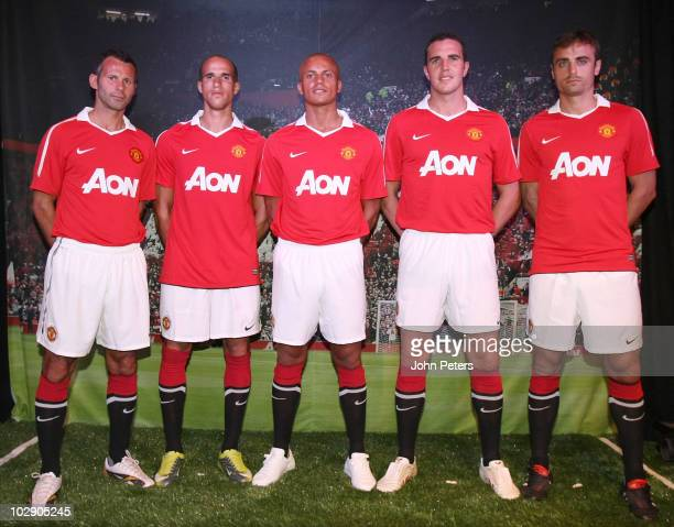 Ryan Giggs Gabriel Obertan Wes Brown John O'Shea and Dimitar Berbatov of Manchester United attend the launch of the new Manchester United home kit...