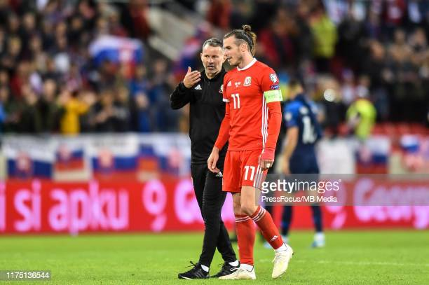 Ryan Giggs head coach of Wales and Gareth Bale talk after the UEFA Euro 2020 qualifier between Slovakia and Wales on October 10, 2019 in Trnava,...