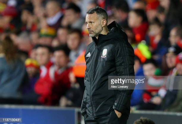 Ryan Giggs Head Coach of Wales looks on during the International Friendly match between Wales and Trinidad and Tobago at Racecourse Ground on March...
