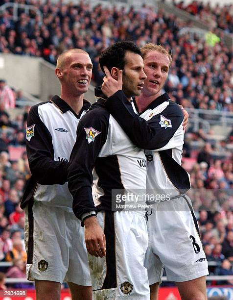 Ryan Giggs is congratulated by Nicky Butt and Luke Chadwick after scoring United's second goal during the FA Barclaycard Premiership match between...