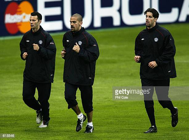 Ryan Giggs Juan Veron and Ruud Van Nistelrooy of Manchester United during training prior to the Champions semifinal second leg match between Bayer...