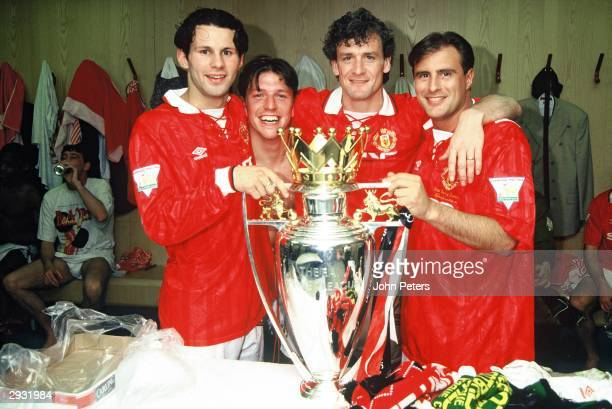 Ryan Giggs Lee Sharpe Mark Hughes and Clayton Blackmore of Manchester United celebrate in the dressing room with the Premiership Trophy after...
