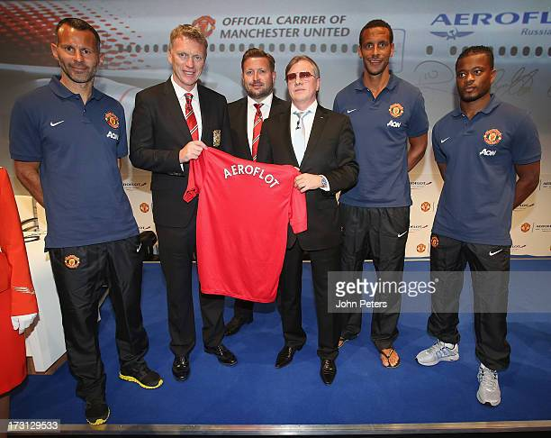 Ryan Giggs Manager David Moyes Group Managing Director Richard Arnold Rio Ferdinand and Patrice Evra of Manchester United pose with CEO of Aeroflot...