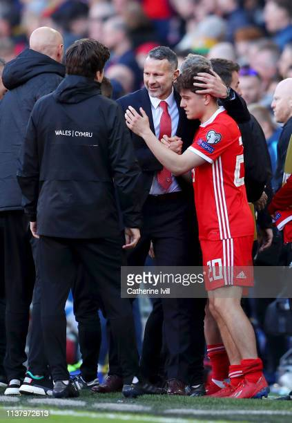Ryan Giggs Manager of Wales embraces Daniel James of Wales during the 2020 UEFA European Championships group E qualifying match between Wales and...