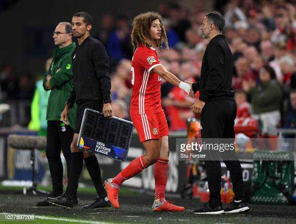 Ryan Giggs Manager of Wales greets Ethan Ampadu of Wales as Ethan Ampadu is substituted off during the UEFA Nations League B group four match between...