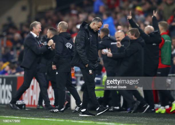 Ryan Giggs Manager of Wales looks dejected as the Denmark bench celebrate Denmark's second goal during the UEFA Nations League Group B match between...