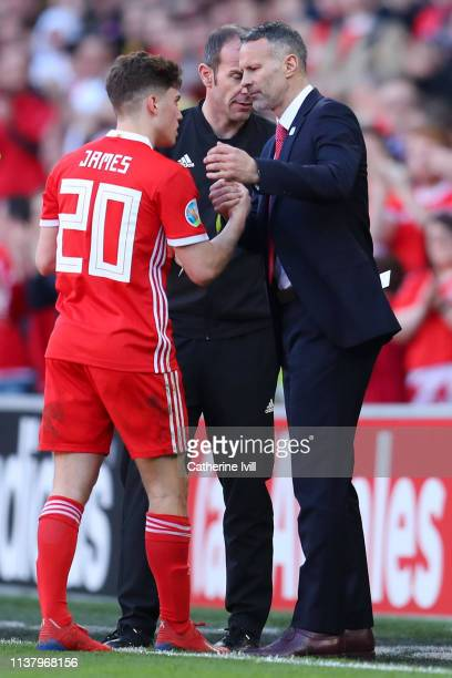 Ryan Giggs Manager of Wales shakes hands with Daniel James of Wales during the 2020 UEFA European Championships group E qualifying match between...