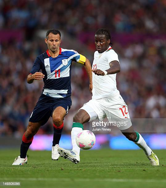 Ryan Giggs of Great Britain battles with Ibrahima Balde of Senegal during the Men's Football first round Group A Match of the London 2012 Olympic...