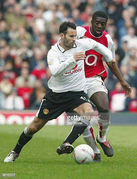 Ryan Giggs of Man Utd clashes with Kolo Toure of Arsenal during the FA Cup Semi Final match between Arsenal and Manchester United at Villa Park on...