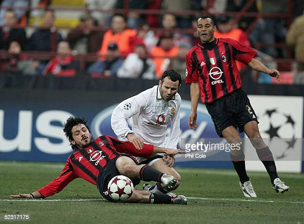 Ryan Giggs of Manchester gets tackled by Gennaro Gattuso of AC Milan during the Champions League last 16 second leg match between Milan and...