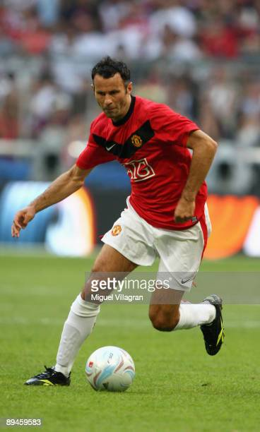 Ryan Giggs of Manchester plays the ball during the Audi Cup tournament semi final match between Boca Juniors v Manchester United at Allianz Arena on...